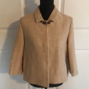 Cream colored Maje woven jacket.